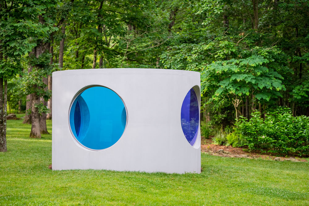 Sarah Braman (born 1970). Here, 2019. Concrete drainage pipe, powder-coated aluminum frames, and laminated glass. 96 × 140 × 140 inches. © Sarah Braman, courtesy of the artist and Mitchell-Innes & Nash, New York. Photo: Ironside Photography, Courtesy of Crystal Bridges Museum of American Art.