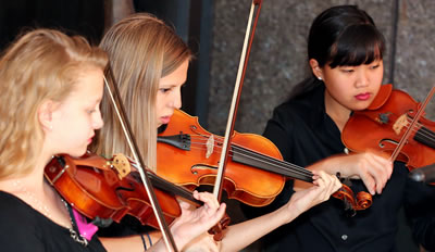 IImage of student musicians of the Naples Philharmonic Youth Orchestra