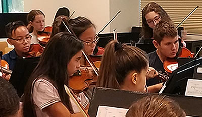 Image of student musicians of the Naples Philharmonic Youth Symphonia